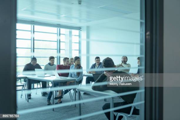 Apprentices studying in classroom of railway engineering facility