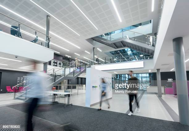 apprentices walking through railway engineering facility - hotel lobby stock pictures, royalty-free photos & images