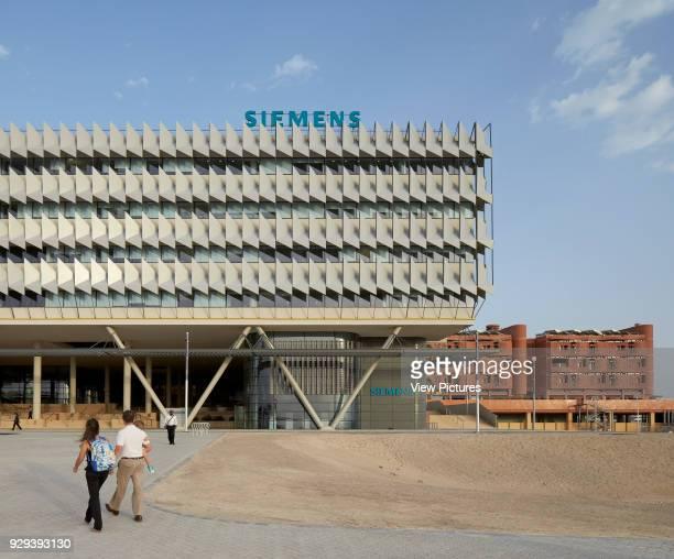 Approach towards headquarters. Siemens Masdar, Abu Dhabi, United Arab Emirates. Architect: Sheppard Robson, 2014.