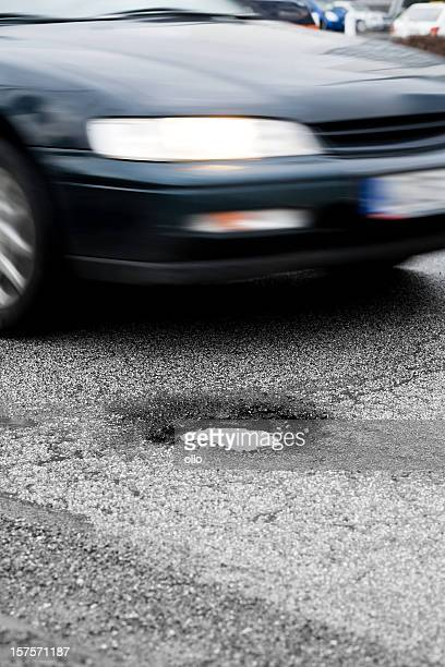 approaching car, pothole - pothole stock photos and pictures