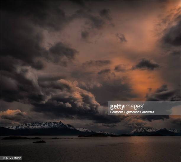 approaching storm and dramatic skies in the beagle channel, tierra del fuego, argentina. - cielo minaccioso foto e immagini stock