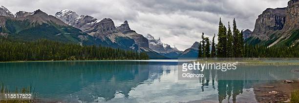 approaching storm at lake maligne - ogphoto stock photos and pictures