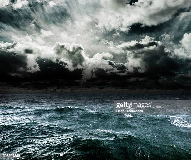 approaching storm over the ocean. - dramatic sky stock pictures, royalty-free photos & images
