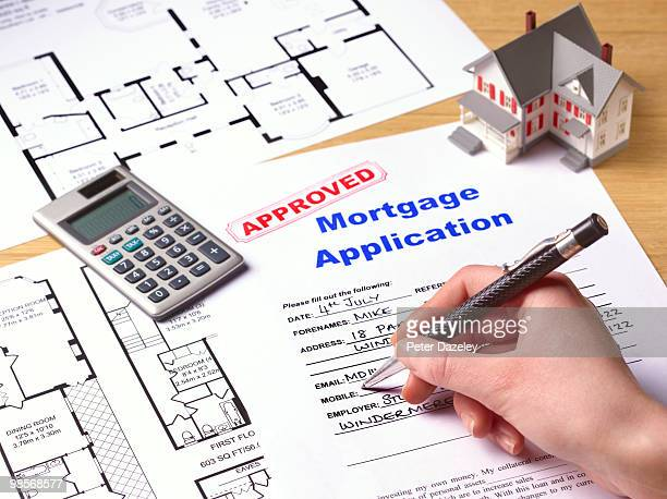 approved mortgage application - mortgage stock pictures, royalty-free photos & images
