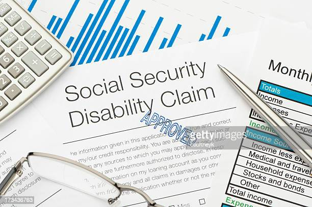approved social security disability claim form - representing stock pictures, royalty-free photos & images
