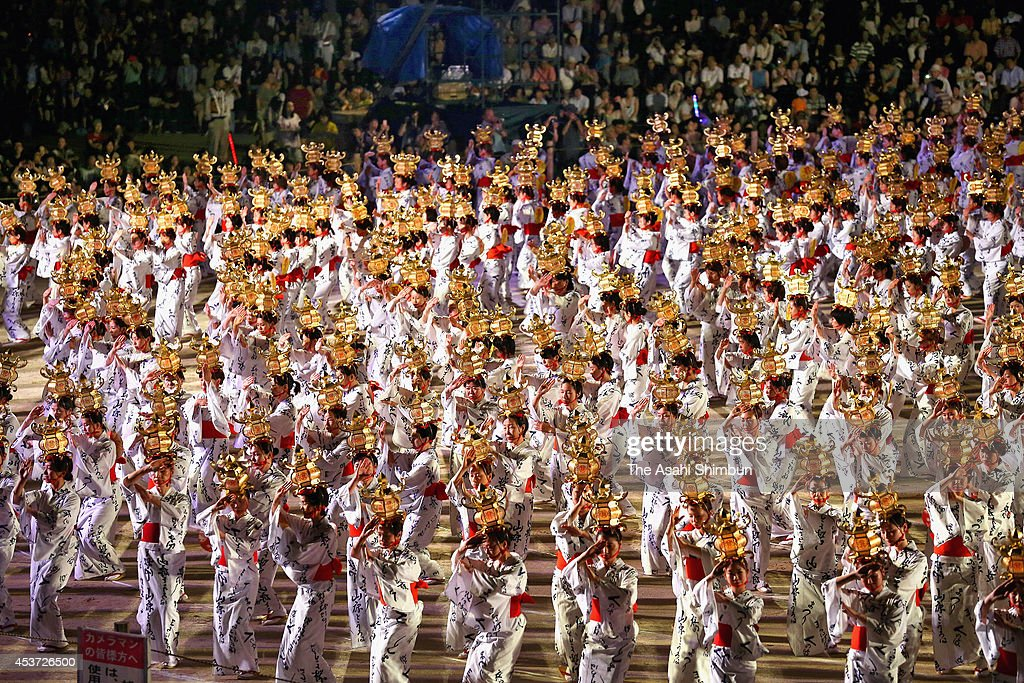 Approximately 1,000 women wearing Yukata, summer kimonos holding the Toro (lanterns) on their heads dance during the Yamaga Toro Festival at Yamaga Elementary School on August 16, 2014 in Yamaga, Kumamoto, Japan.