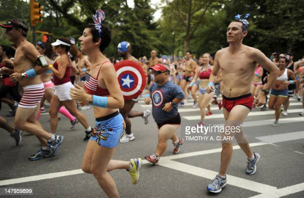 """Approximately 500 triathletes after the start of a 17 mile run through Central Park July 6 2012 in their briefs as part of the """"Celebrate America""""..."""