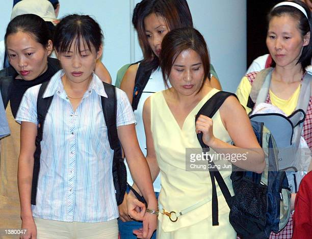 Approximately twentyone North Korean asylum seekers arrive at the Incheon International Airport after traveling from Beijing via the Philippines...