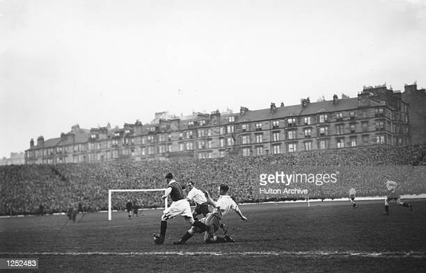 Morgan of Scotland beats two English defenders during the Home Championship match at Hampden Park, Glasgow. The game finished in a 2-2 draw with...
