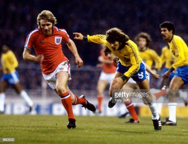 Tony Currie of England and Zico of Brazil in action during an International Friendly at Wembley in London Mandatory Credit Tony Duffy /Allsport