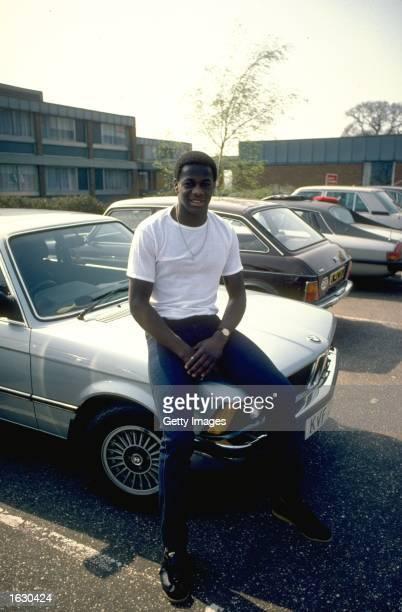 Justin Fashanu of Norwich City sits on the bonnet of his car Mandatory Credit Allsport UK /Allsport