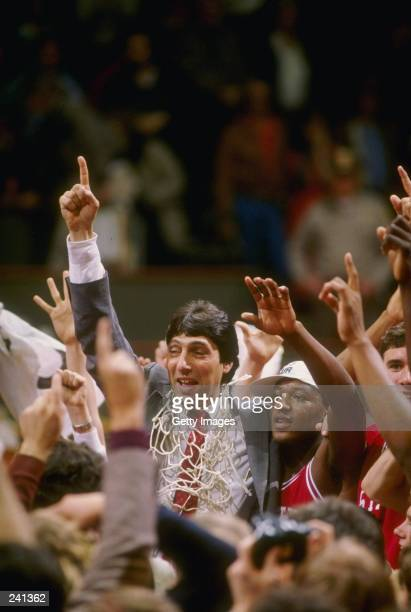 Head coach Jim Valvano of the North Carolina State Wolfpack celebrates with his team after the Wolfpack defeated the Houston Cougars 5452 in the NCAA...
