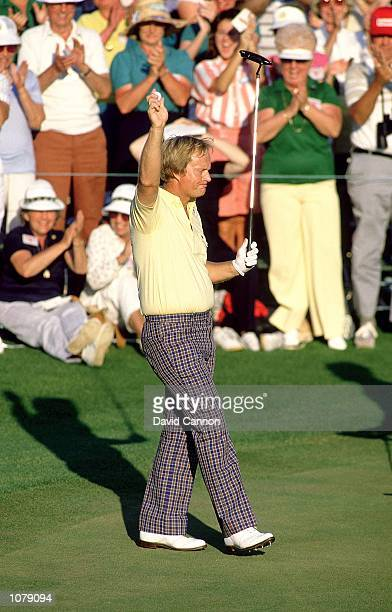 Jack Nicklaus of the USA celebrates on the final green after victory in the US Masters at Augusta National in Georgia USA Mandatory Credit David...