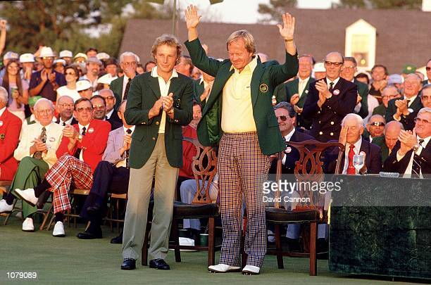 Jack Nicklaus of the USA receives the Green Jacket from previous winner Bernhard Langer of Germany after victory in the US Masters at Augusta...