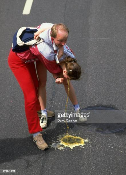 Kersti Jakobsen of Denmark vomits after the Mars London Marathon Jakobsen finished in sixth place with a time of 23253 hours Mandatory Credit David...