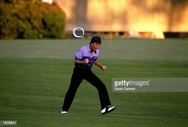 Larry Mize of the USA celebrates chipping in on the second playoff hole number 11 to win the masters during the US Masters 1987 held at the Augusta...