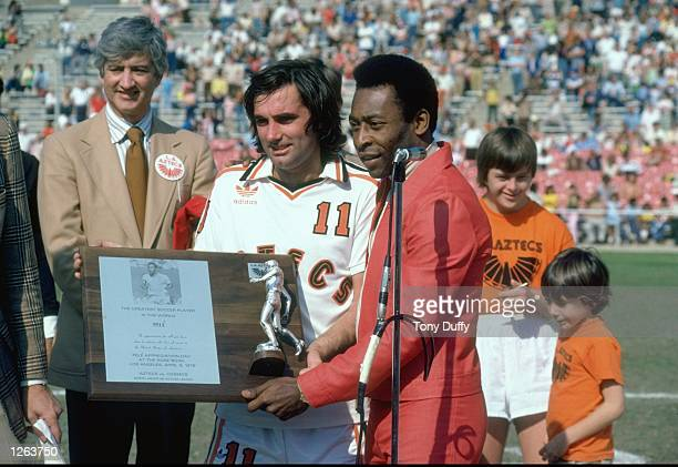 Pele of Brazil is presented with the Greatest Soccer Player Trophy by George Best of Aztecs before an American League match between Aztecs and NY...