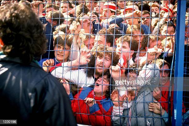 Supporters are crushed against the barrier as disaster strikes before the FA Cup semi-final match between Liverpool and Nottingham Forest played at...