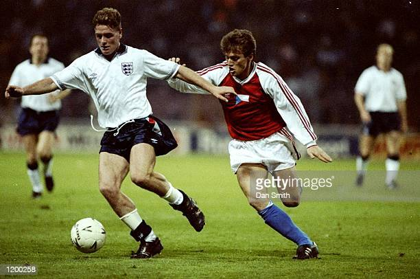 Paul Gascoigne of England gets away from Lubomir Moravcik of Czechoslovakia during a Friendly match at Wembley Stadium in London. England won the...