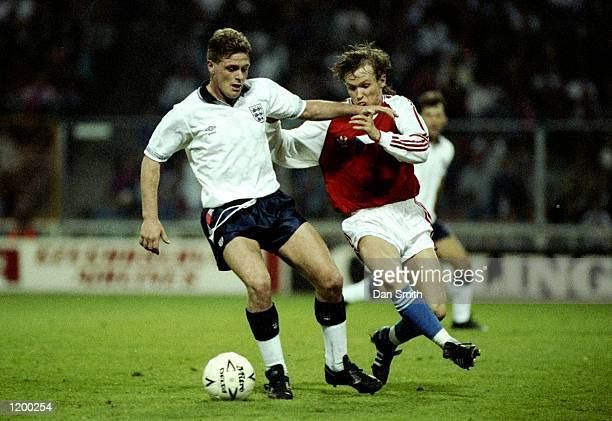 Paul Gascoigne of England is tackled by Ivan Hasek of Czechoslovakia during a Friendly match at Wembley Stadium in London England won the match 42...
