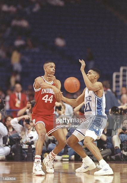 Antonio Lang of the Duke Blue Devils guards Alan Henderson of the Indiana Hoosiers during a playoff game at the Hubert H Humphrey Metrodome in...
