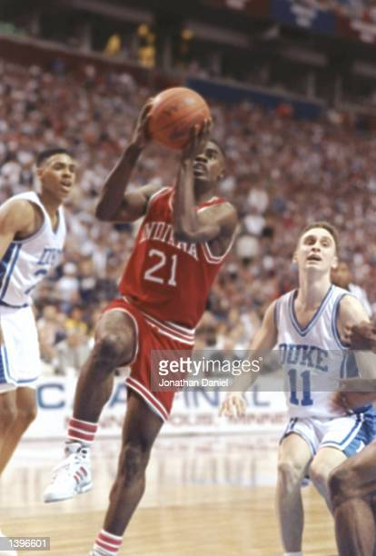 Chris Reynolds of the Indiana Hoosiers drives past guard Bobby Hurley of the Duke Blue Devils during a playoff game at the Hubert H Humphrey...