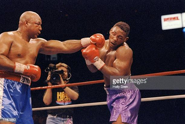 George Foreman lands a punch to the head of Alex Stewart Mandatory Credit Holly Stein /Allsport