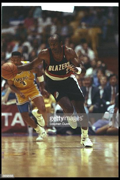 Guard Clyde Drexler of the Portland Trail Blazers moves the ball during a game against the Los Angeles Lakers at the Great Western Forum in Inglewood...
