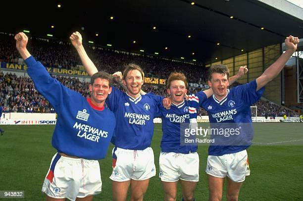 Ian Durrant Gary Stevens Stuart McCall and Nigel Spackman of Rangers celebrate winning the championship after a Scottish Premier League match against...