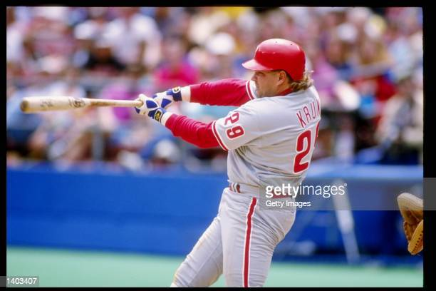 Infielder John Kruk of the Philadelphia Phillies swings at the ball during a game against the Pittsburgh Pirates at Three Rivers Stadium in...