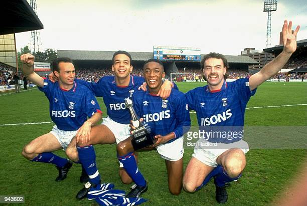 Simon Milton, Jason Dozzell, Chris Kiwomya and John Wark of Ipswich Town celebrate after becoming League Division Two Champions after a 1-1 draw with...