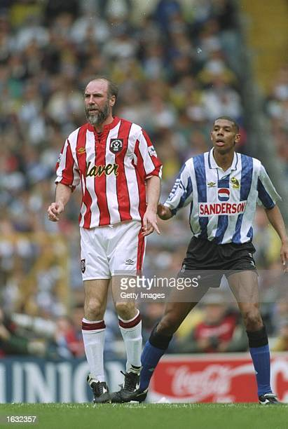 Alan Cork of Sheffield United and Carlton Palmer of Sheffield Wednesday keep an eye on the ball during the FA Cup semifinal at the Hillsborough...