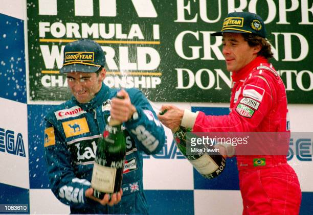 Formula One European Grand Prix winner Ayrton Senna of the McLaren Ford team sprays second placed Williams Renault driver Damon Hill with champagne...