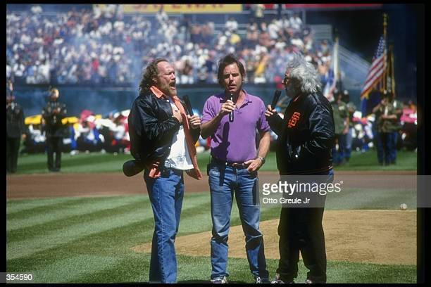 Grateful Dead band members Vince Welnick Bob Weir and Jerry Garcia sing during a game between the Florida Marlins and the San Francisco Giants