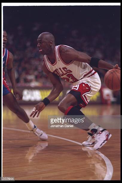 Guard Michael Jordan of the Chicago Bulls moves the ball during a game against the Detroit Pistons at the United Center in Chicago Illinois Mandatory...