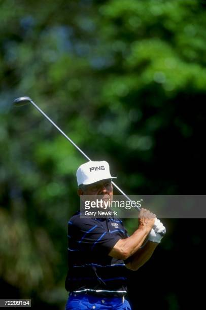 Joe Jimenez watches the ball after his swings during the PGA Seniors Championships at the PGA National Golf Course in Palm Beach Gardens in Florda