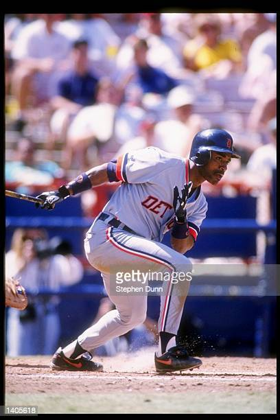 Outfielder Tony Phillips of the Detroit Tigers drops the bat and runs during a game against the California Angels at Anaheim Stadium in Anaheim...