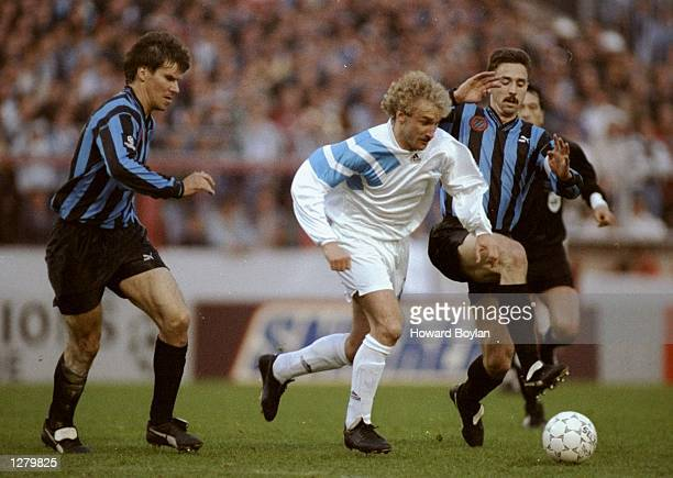 Rudi Voeller of Marseille gets away from Lorenzo Staelens of Club Brugge KV during a Champions League match at the Olympic Stadium in Bruges Belgium...