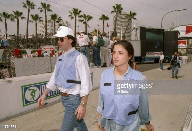 Actor Jerry Seinfeld and Shoshana Loenstein walk during the Long Beach Grand Prix in Long Beach California Mandatory Credit Al Bello /Allsport
