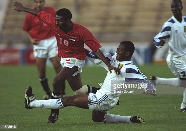 Ahmed Abdou El Kass of Egypt holds off Amadou Diallo of Mali during the African Cup of Nations QuarterFinal at the Olympic Stadium in El Menzah Tunis...