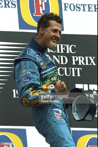 Benetton Ford driver Michael Schumacher of Germany celebrates after winning the Pacific Grand Prix at the TI circuit in Aida Japan Mandatory Credit...