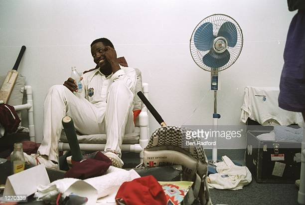 Brian Lara of the West Indies celebrates in the dressing room after scoring a record 375 runs during the Fifth Test match against England at the...