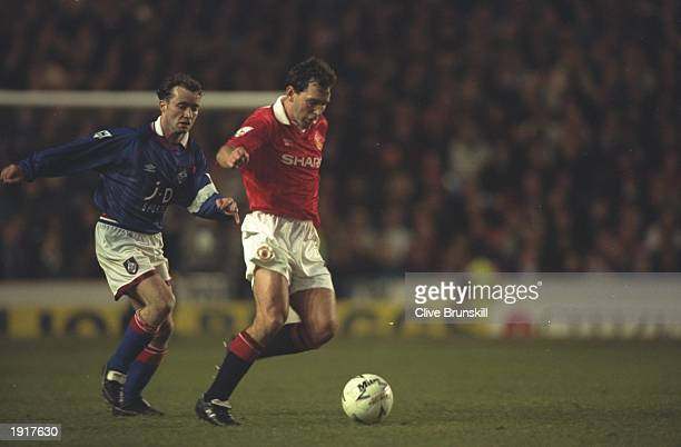 Bryan Robson of Manchester United is marked by Mike Milligan of Oldham during the FA Cup semifinal replay at Maine Road in Manchester Manchester...