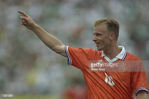 Dennis Bergkamp of Holland indicates to his team mates during a World Cup Second Round match against Ireland at the Citrus Bowl in Orlando Florida...