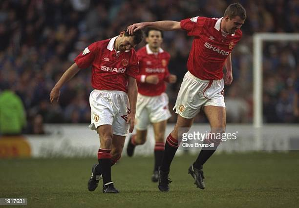 Gary Pallister and Bryan Robson both of Manchester United celebrate during the FA Cup semifinal replay against Oldham at Maine Road in Manchester...