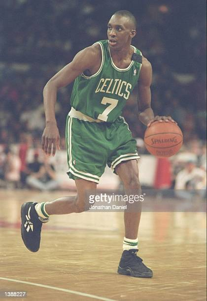 Guard Dee Brown of the Boston Celtics dribbles the ball down the court during a game against the Chicago Bulls at Chicago Stadium in Chicago Illinois...