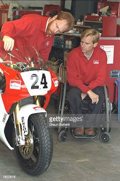 Marlboro Team Boss Wayne Rainey of the USA checks out a motorcycle before the Japanese Grand Prix at the Suzuka circuit in Japan Mandatory Credit...