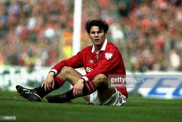 Ryan Giggs of Manchester United sits on the pitch during the FA Cup semifinal against Oldham Athletic at WEembley Stadium in London England Mandatory...