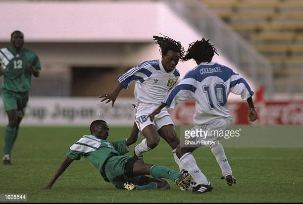 Soumano Oushane of Mali is tackled by Harrison Chonto of Zambia during the African Cup of Nations SemiFinal at the Olympic Stadium in El Menzah Tunis...