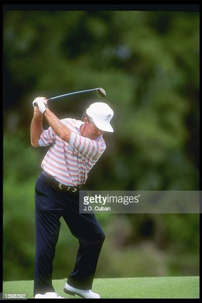 Gary Player of South Africa prepares to drive the ball at the PGA Senior Championship at the PGA National Resort and Spa in Palm Beach, Florida.